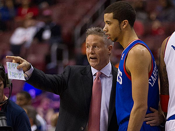 76ers head coach Brett Brown and point guard Michael Carter-Williams. (Chris Szagola/AP)