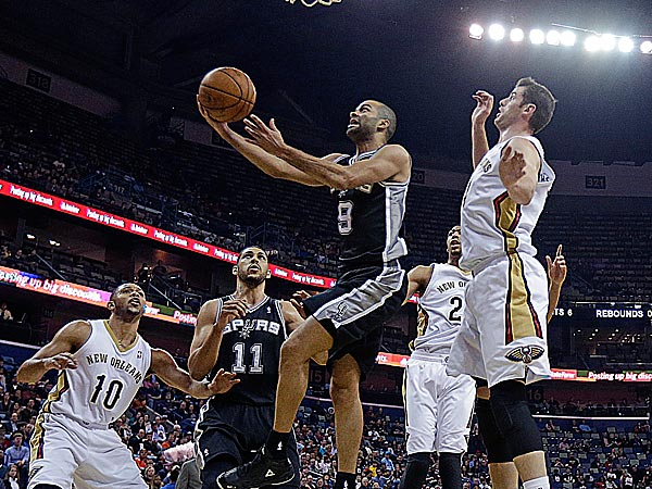 Spurs point guard Tony Parker goes to the basket against Pelicans shooting guard Eric Gordon, power forward Anthony Davis, center Jason Smith and point guard Brian Roberts. (Gerald Herbert/AP)
