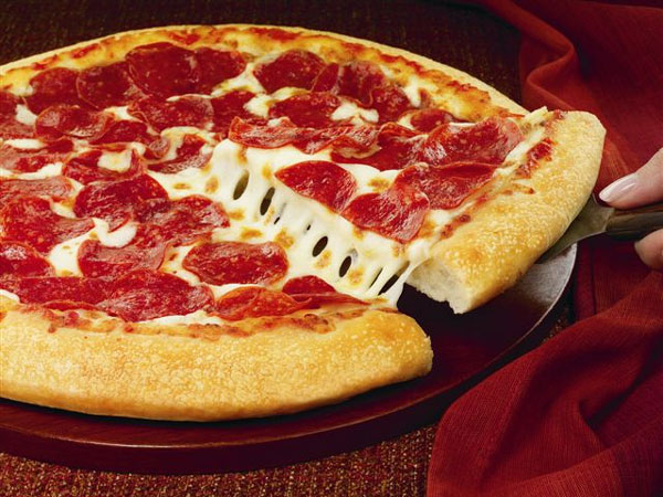 This handout photo provided by Pizza Hut, shows a hand-tossed pizza. (AP Photo/Pizza Hut-HO)