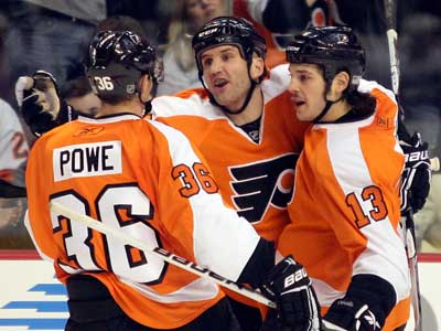 Dan Carcillo, right, and the Flyers expect a rough game in Toronto tonight. (Yong Kim / Staff Photographer)