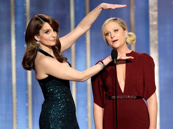 Co-hosts Tina Fey and Amy Poehler at the 70th Golden Globes. (AP Photo)