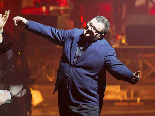 Israeli fashion designer Alber Elbaz appears at the end of  the fashion house Lanvin collection  for her the Fall-Winter, ready-to-wear 2013 fashion collection, during Paris Fashion week,  Friday, March 2, 2012. (AP Photo/Jacques Brinon)