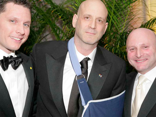 Restaurateur Marc Vetri (center), with business partners Jeff Michaud (left) and Jeff Benjamin, was recovering from shoulder surgery in January at the Lemon Ball. (REUBEN HARLEY)