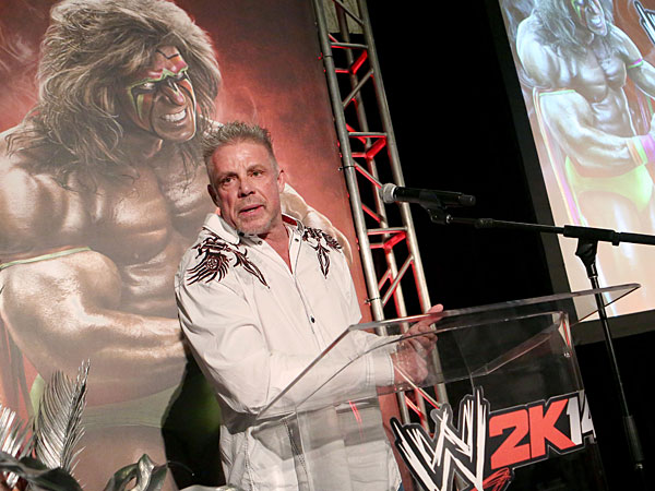 Ultimate Warrior talks about his career as the Ultimate Warrior, a playable WWE Legend, available exclusively by pre-ordering WWE 2K14, on Sunday, Aug. 18, 2013 in Los Angeles. (Photo by Casey Rodgers/Invision for 2K/AP Images)