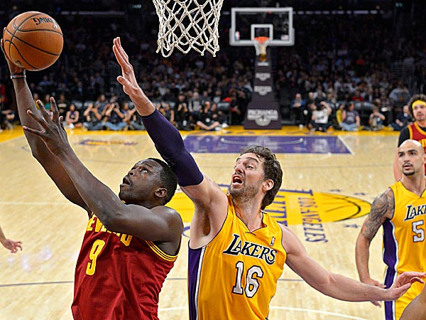 Cavaliers forward Luol Deng puts up a shot as Lakers center Pau Gasol defends. (Mark J. Terrill/AP)
