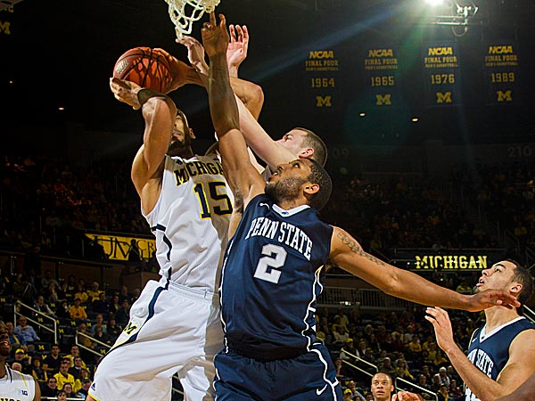 Michigan forward Jon Horford beats Penn State guard D.J. Newbill to a rebound. (Tony Ding/AP)