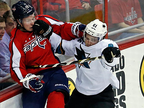 Sharks defenseman Justin Braun boards Capitals center Nicklas Backstrom. (Alex Brandon/AP)
