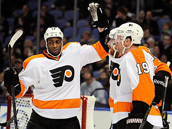 The Flyers´ Wayne Simmonds celebrates with Jakub Voracek and Scott Hartnell after a goal by Voracek during the second period. (Gary Wiepert/AP)