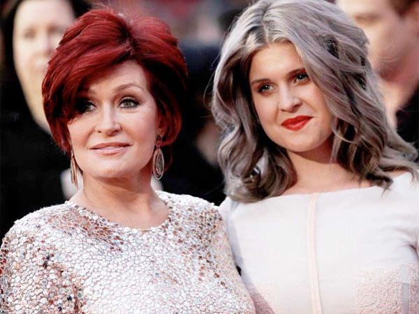 Sharon Osbourne, left, and Kelly Osbourne arrive at the People´s Choice Awards on Wednesday, Jan. 11, 2012 in Los Angeles. (AP Photo/Matt Sayles)