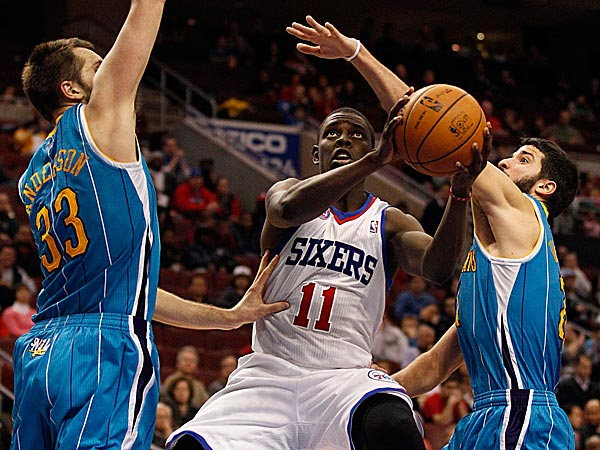 Sixers guard Jrue Holiday gets fouled driving to the basket. (Yong Kim/Staff Photographer)