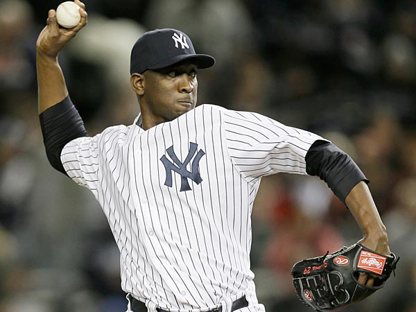 New York Yankees´ pitcher Rafael Soriano throws in the tenth inning of Game 1 of the American League championship series against the Detroit Tigers Saturday, Oct. 13, 2012, in New York. (AP Photo/Matt Slocum)
