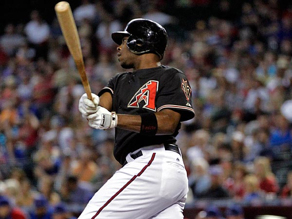 Arizona Diamondbacks´ Justin Upton connects for an RBI single against the Chicago Cubs during the first inning of a baseball game, Saturday, Sept. 29, 2012,in Phoenix. (AP Photo/Matt York)