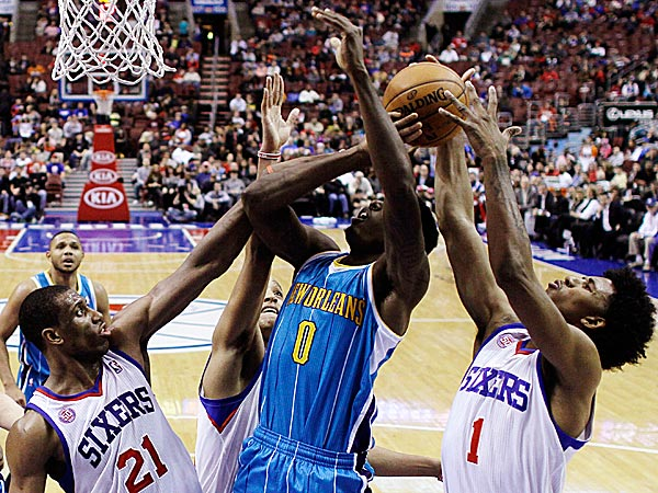 The Hornets´ Al-Farouq Aminu tries to get a shot off as the 76ers´ Thaddeus Young, Evan Turner and Nick Young defend. (Matt Slocum/AP)