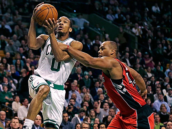 Celtics guard Avery Bradley is fouled by Raptors forward Chuck Hayes. (Charles Krupa/AP)