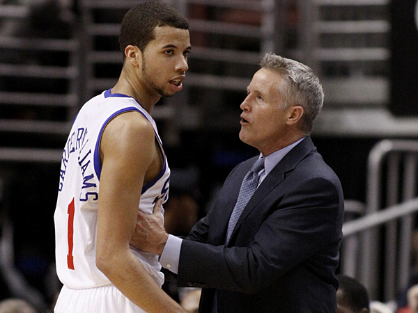 76ers rookie point guard Michael Carter-Williams talks to coach Brett Brown. (H. Rumph Jr./AP)