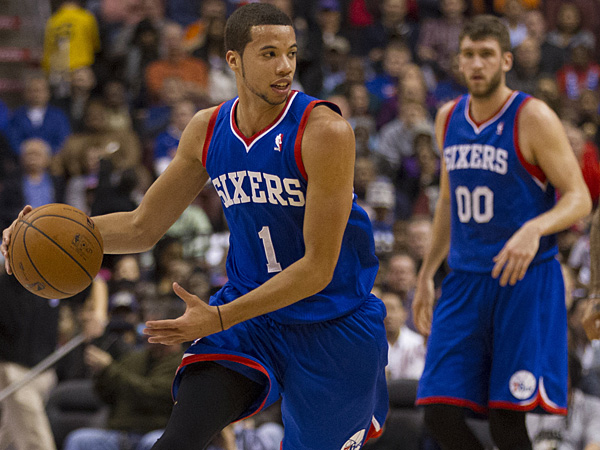 76ers rookie point guard Michael Carter-Williams (left) and veteran center Spencer Hawes. (Chris Szagola/AP)