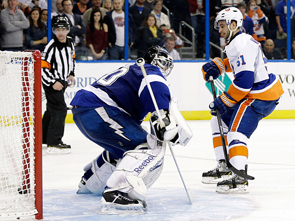 Islanders center Frans Nielsen (51), of Denmark beats Tampa Bay Lightning goalie Ben Bishop (30) during a shoot out in an NHL hockey game, Thursday, Jan. 16, 2014, in Tampa, Fla. The Islanders won the game 2-1. (Chris O´Meara/AP)