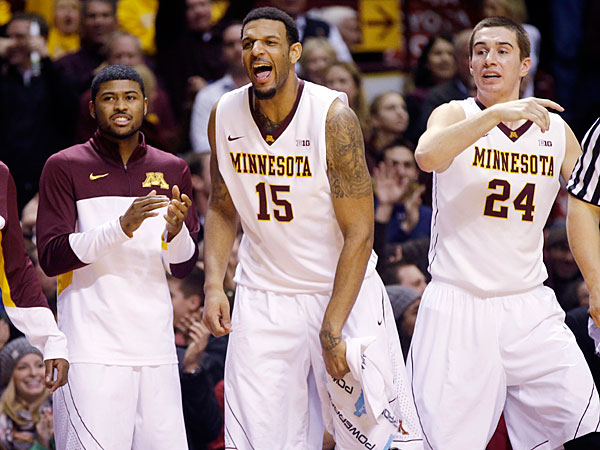 Minnesota´s Maurice Walker (15), Joey King (24) and others celebrate a basket late in the second half of an NCAA college basketball game against Ohio State, Thursday, Jan. 16, 2014, in Minneapolis. Minnesota won 63-53. (Jim Mone/AP)