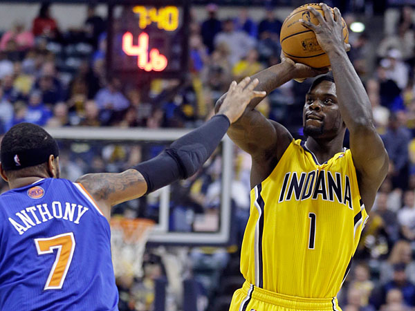 Pacers guard Lance Stephenson shoots over New York Knicks forward Carmelo Anthony during the second half of an NBA basketball game in Indianapolis, Thursday, Jan. 16, 2014. The Pacers defeated the Knicks 117-89. (Michael Conroy/AP)