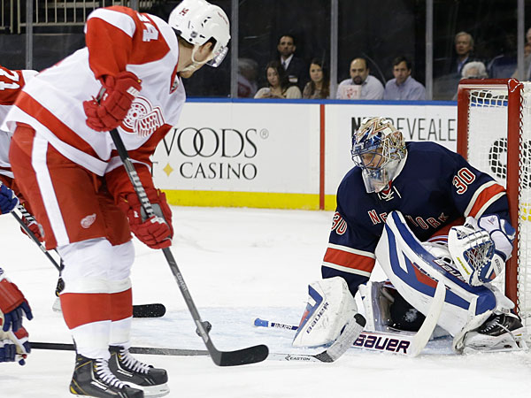 Rangers goalie Henrik Lundqvist (30), of Sweden, deflects a shot on the goal by Detroit Red Wings´ Gustav Nyquist (14) during the first period of an NHL hockey game Thursday, Jan. 16, 2014, in New York. (Frank Franklin II/AP)