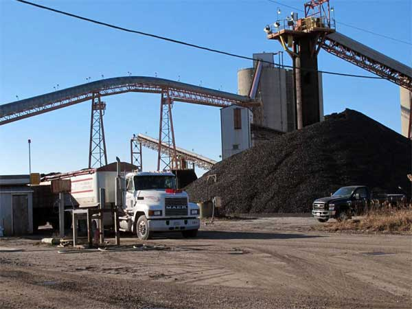 FILE - In this Dec. 26, 2013 file photo a coal truck is loaded with another payload at the Crown III underground coal mine near Farmersville, Ill. The Federal Reserve reports on the country´s industrial production for December on Friday, Jan. 17, 2014. (AP Photo/Jim Suhr)