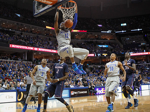 Memphis forward David Pellom (12) dunks against Connecticut forward Deandre Daniels (2) and center Amida Brimah (35) during the second half of an NCAA college basketball game Thursday, Jan. 16, 2014, in Memphis, Tenn. Connecticut won 83-73. (Lance Murphey/AP)