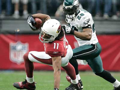Would Larry Fitzgerald welcome Donovan McNabb in Arizona? (Eric Mencher / Staff Photographer)