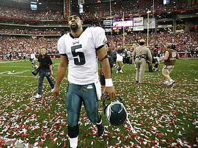 Donovan McNabb walks off the field after the Eagles´ loss. (Eric Mencher/Staff Photographer)