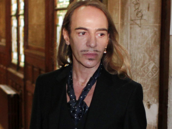 FILE -In this June 22, 2011 file photo, former Dior designer John Galliano arrives at the Paris court house, charged with hurling anti-Semitic slurs in a Paris cafe. Galliano has been invited to return to fashion in the studio of Oscar de la Renta. De la Renta invited Galliano to spend time in his office over the next three weeks, according to a statement released Friday by de la Renta´s company. Galliano was dismissed as creative director of Christian Dior and left his own label two years ago after an anti-Semitic rant at a Paris cafe was captured on video. A French court also convicted him on two other complaints of anti-Semitic behavior.  (AP Photo/Thibault Camus, File)
