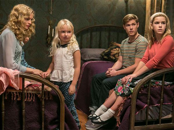 """Flowers in the Attic"" stars Heather Graham (left) as mom Corrine Dollanganger, up above the rafters with children (from left) Carrie (Ava Telek), Christopher (Mason Dye) and Cathy (Kiernan Shipka)."