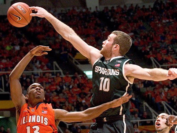 Michigan State´s forward Matt Costello (10) knocks a shot away from Illinois´ Tracy Abrams (13) during an NCAA college basketball game in Champaign, Ill., on Saturday, Jan. 18, 2014. (Robin Scholz/AP)