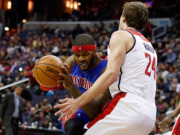 Pistons forward Josh Smith (6) is fouled by Washington Wizards forward Jan Vesely (24), from the Czech Republic, in the first half of an NBA basketball game, Saturday, Jan. 18, 2014, in Washington. (Alex Brandon/AP)