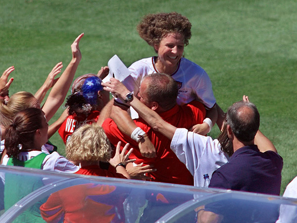 Michelle Akers during her playing days. Here she´s celebrating after scoring a goal against Brazil in the 1999 Women´s World Cup. (Eric Risberg/AP file photo)