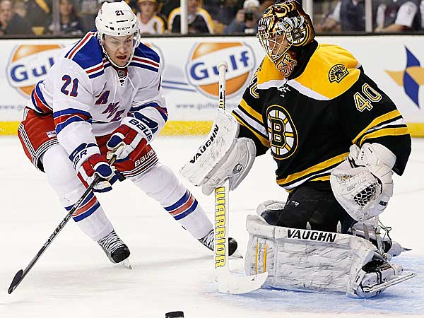 New York Rangers´ Derek Stepan (21) skates for the rebound off Boston Bruins goalie Tuukka Rask (40), of Finland, during the first period of an NHL hockey game in Boston, Saturday, Jan. 19, 2013. (Michael Dwyer/AP)