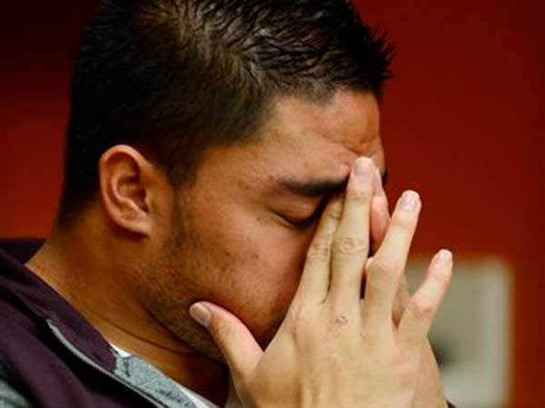 In a photo provided by ESPN, Notre Dame linebacker Manti Te´o pauses during an interview with ESPN on Friday, Jan. 18, 2013, in Bradenton, Fla. ESPN says Te´o maintains he was never involved in creating the dead girlfriend hoax. He said in the off-camera interview.