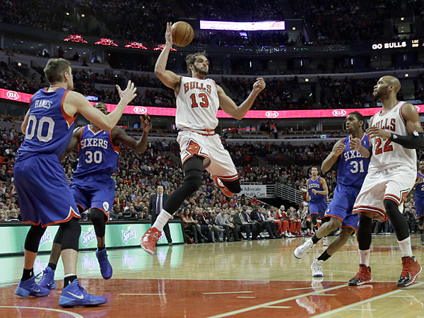 Bulls center Joakim Noah looks to a pass during the second half against the 76ers. (Nam Y. Huh/AP)