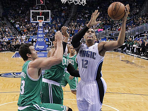 The Magic´s Tobias Harris gets to the basket for a shot past the Celtics´ Kris Humphries and Jared Sullinger. (John Raoux/AP)