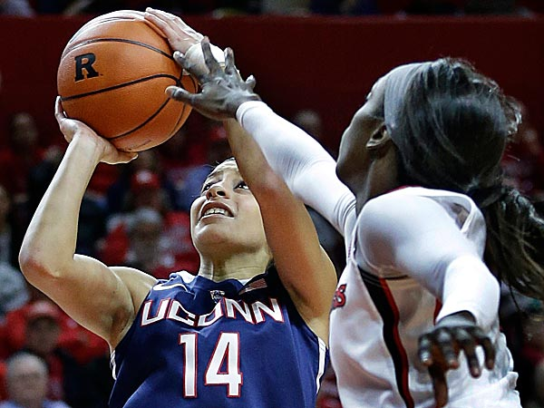 Connecticut guard Bria Hartley takes a shot as Rutgers forward Kahleah Copper tries to block her path. (Mel Evans/AP)