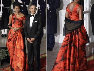 First lady Michelle Obama stands beside President Barack Obama at the White House for the State Dinner. (AP Photo / Charles Dharapak)