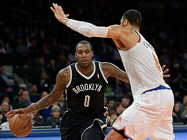 The Nets´ Andray Blatche tries to move past the Knicks´ Tyson Chandler. (Seth Wenig/AP)