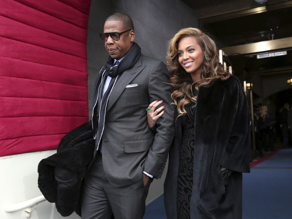Recording artists Jay-Z and Beyonce arrive on the West Front of the Capitol in Washington, Monday, Jan. 21, 2013, for the Presidential Barack Obama´s ceremonial swearing-in ceremony during the 57th Presidential Inauguration.  (AP Photo/Win McNamee, Pool)