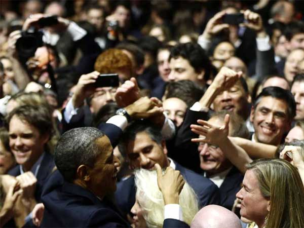 President Barack Obama greets supporters and donors at an inaugural reception for the 57th Presidential Inauguration at The National Building Museum in Washington, Sunday, Jan. 20, 2013. (AP Photo/Charles Dharapak)