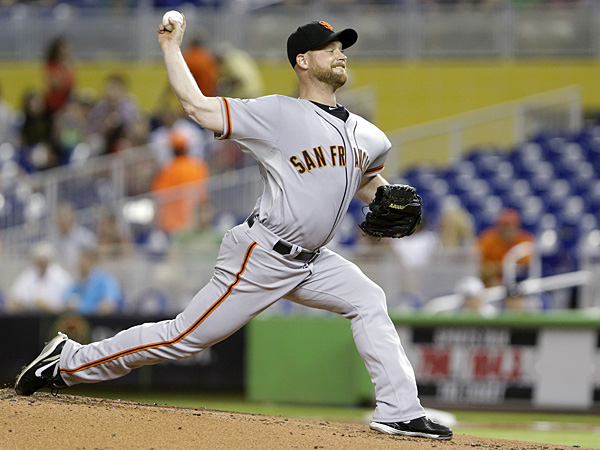 Chad Gaudin pitching for the San Francisco Giants in August 2013. (Wilfredo Lee/AP)