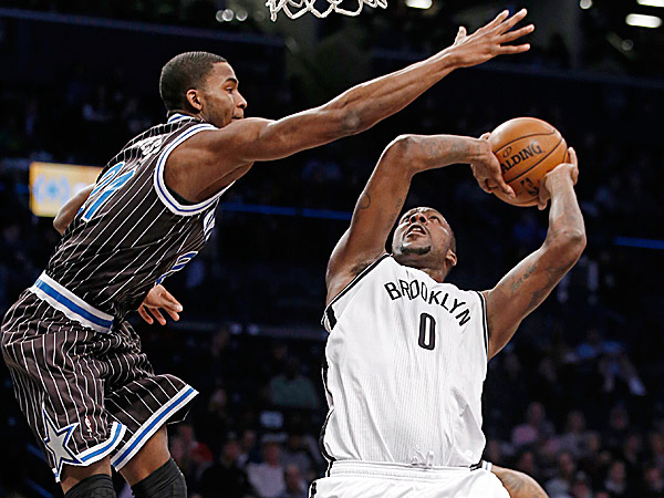 Magic forward Maurice Harkless tries to block a shot by Nets center Andray Blatche. (Kathy Willens/AP)
