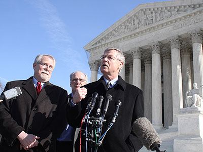 Common Cause Public Campaign President Nick Nyhard, right, accompanied by Common Cause President Bob Edgar, left, and Campaign Legal Center Executive Director Gerald Hebert, center,  during a news conference after the Supreme Court campaign finance ruling. (AP Photo / Lauren Victoria Burke)