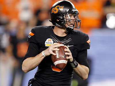 Oklahoma State´s Brandon Weeden could be of interest to the Eagles in the NFL draft. (Paul Connors/AP file photo)