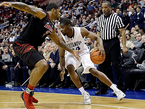 Villanova´s Achraf Yacoubou, right, dribbles against Louisville´s Chane Behanan. (Matt Slocum/AP)
