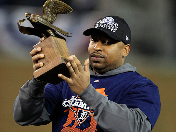 Detroit Tigers´ Delmon Young holds the most valuable player trophy after his team won Game 4 of the American League championship series, 8-1, against the New York Yankees, Thursday, Oct. 18, 2012, in Detroit. The Tigers move on to the World Series. (AP Photo/Carlos Osorio)