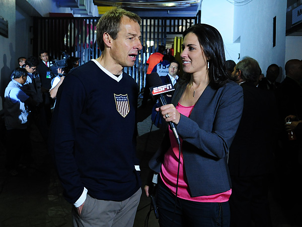 ESPN´s Mónica González with United States men´s national team coach Jurgen Klinsmann during last year´s Mexico-U.S. World Cup qualifier at the Estadio Azteca in Mexico City. (Photo courtesy of ESPN)