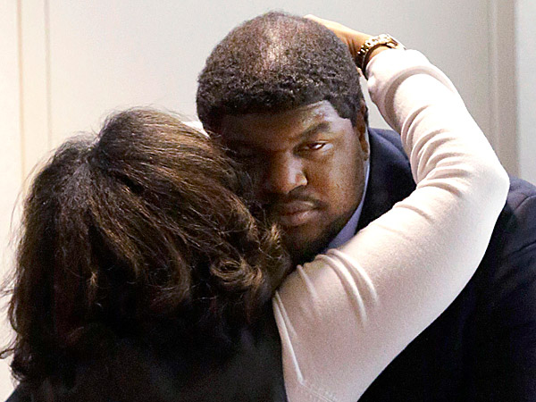 Former Dallas Cowboys NFL football player Josh Brent gets a hug from family after closing arguments in his intoxication manslaughter trial. (LM Otero/AP)